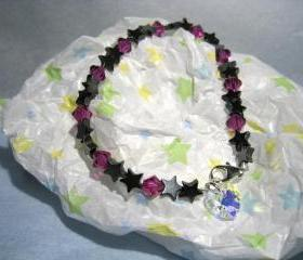 Luckystars Bracelet w/hematite starts and fushia 6mm Swarovski beads and a dangling Swarovski Heart