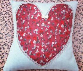 Red ditzy floral heart cushion.