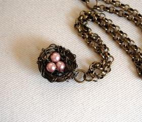 Bird nest necklace with pink pearl