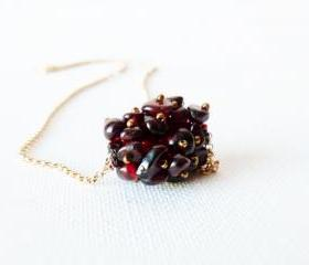 January birthstone. Garnet unique beaded bead pendant on gold field chain.