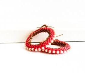 Elegant red hoop earrings. white bronze bead woven round shapes. tbteam.