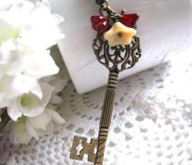 Key To My Heart Necklace - Antiqued Bronze Large Long Skeleton Key, Ruby Siam and Matte Opaque Beige Czech Flower, Woodland Insp