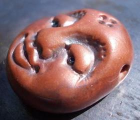 Handmade polymer clay smiling face focal bead pendant, antique copper blue patina, primitive art, handmade jewelry supplies, metallic