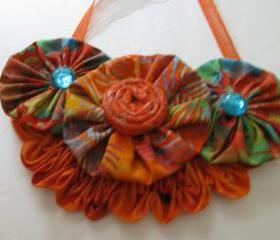 Orange Yo Yo Bib Necklace