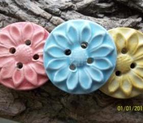 Handmade pink stoneware clay flower button