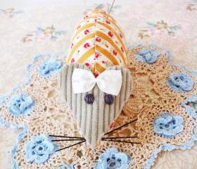 vintage style mouse pin cushion with mustard fabric and floral pins