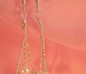 Glass pearl earrings on silver plated wire hung on silver plated earwire