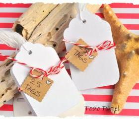 25 White tags with string. Scalloped edge.