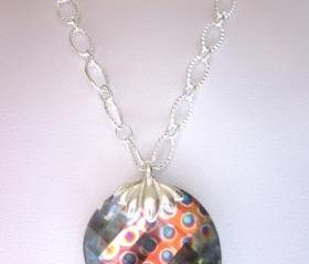 Necklace, Sparkling Swarovski Crystal Peacock Eye faceted Twist pendant on a silver chain.