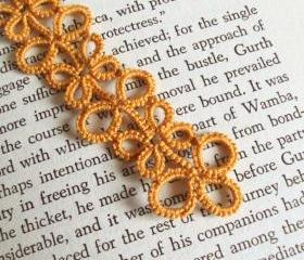 Gold bookmark in tatted lace