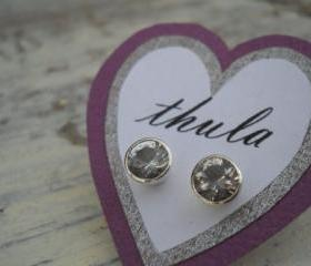 white topaz studs earrings