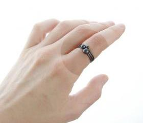 Silver pebble stacking rings . Black oxidized . Set of three