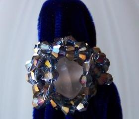 Ring sz 7 adjustable - Wire Wrapped Copper over Aluminum with Blue Crystal Bicone