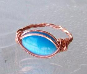 Ring sz 7.5 - Wire Wrapped Twisted Copper with Blue Fiber Optic Stone