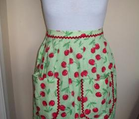 Handmade Bright Cherry Pattern Half Apron with green lining and red rick rack accents