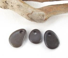 Top drilled beach pebbles. Spanish drilled beach rocks. 3 Natural and smooth beads by Ocean gifts.