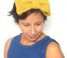 Enormous bow fascinator, crochet headband in burnt yellow.