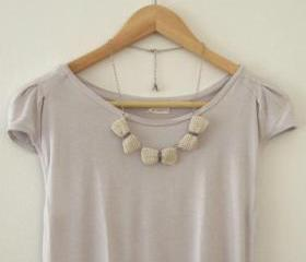 Three crochet bows necklace. Ecru and grey cotton yarn