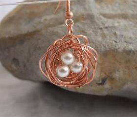 Copper nest earrings: A cute pair of earrings made from copper wire and white pearl beads.