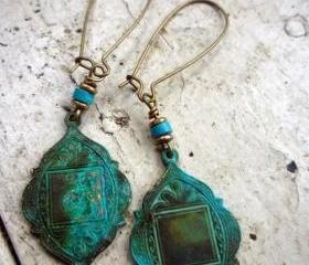 Arabian Medallions in Verdigris Patina. Cocunut rondelle bead. Brass spacer beads. Brass kidney ear wire. Green. Turquoise.