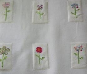 baby girls baby blanket with flowers in cream