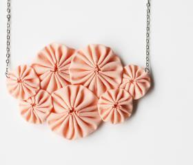 Peach yoyo necklace