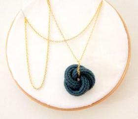 Etarnally. Crochet knot pendant in cypress green