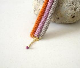 Orbits, crochet bracelet in lavender, orange and sand