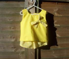 Girls yellow sleeveless top and shorts set