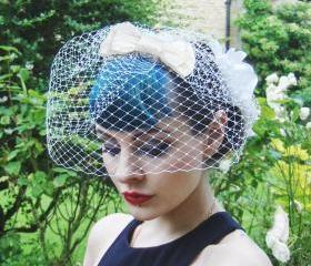 Ivory silk bow birdcage veil.