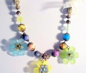 floral bib necklace with ribbon woven chain