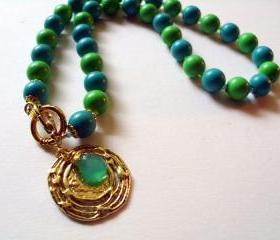 Gold disc lariat necklace with blue and green vintage beads