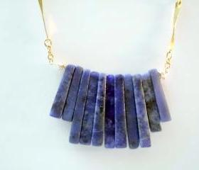 Dark blue stone necklace in tribal style with gold filled chain