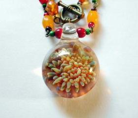 blown glass pendant necklace with beaded chain, flame flower