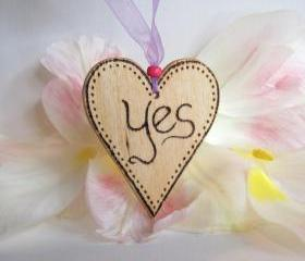 YES - a loving wooden heart answers....
