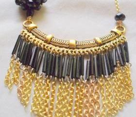 black and gold bib necklace with chain fringe