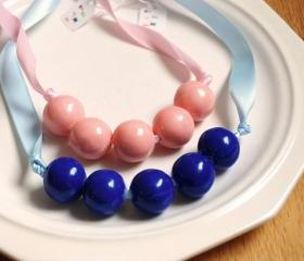 1 Gum ball necklace (edible) 