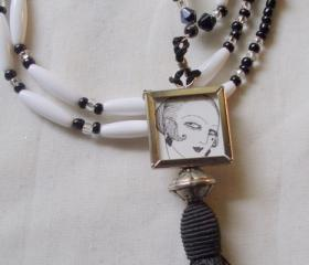flapper necklace in black and white with tassel and picture charm