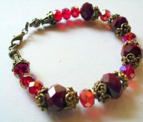 Art Nouveau red crystal bracelet with vintage bead caps