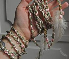 Handfasting cord in sage green and dusky pink, featuring delicate rose braid and feather embellishments