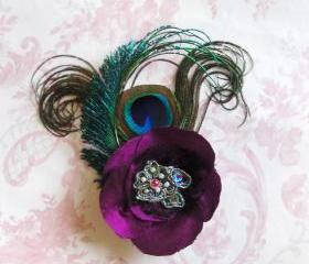 Magenta silk peacock feather corsage.
