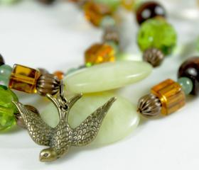 green earth tone beaded necklace with bird charm
