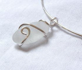 White sea glass pendant on silver choker