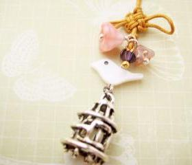 Phone charm with Chinese knot, shell bird and Czech glass flowers - Palace Garden