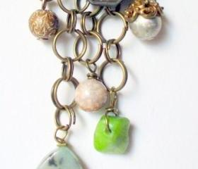 layered chain necklace with blue and green stone pendants and beads