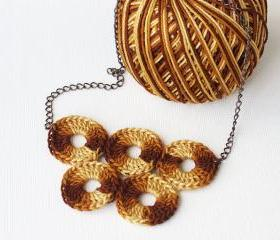 Crochet necklace brown rust yellow marbled olympic circles quintette fiber art epictt therougett efpteam tbteam