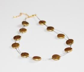 Gold and black discs floating multi strand illusion necklace