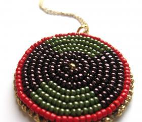 Bead embroidered red, gold olive and purple pendant necklace with gold chain