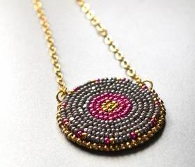 Pink and gray seed bead embroidered pendant on gold plated chain