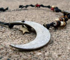 Leather cord necklace with metal Moon and Star pendants
